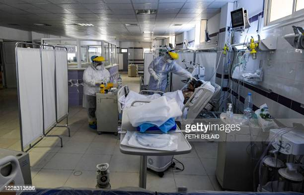 Nurses clad in PPE tend to an intubated COVID-19 coronavirus disease patient in an intensive care unit at a hospital in the town of Gabes in...