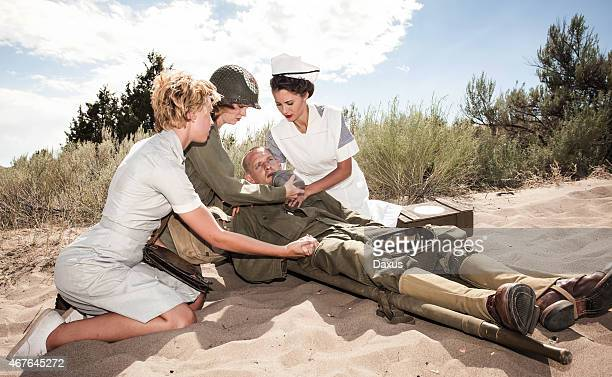 wwii nurses comforting a soldier - hot nurse stock photos and pictures