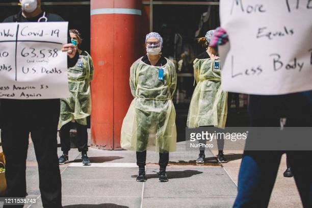 Nurses counter protest at the Re-Open Illinois Protest outside of Thompson Center in Chicago IL during protest restrictions instituted by the...