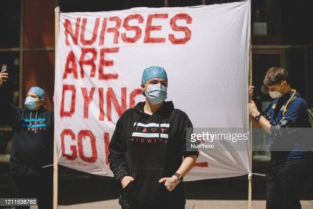 Nurses counter protest at the Re-Open Illinois Protest outside of Thompson Center in Chicago during protest restrictions instituted by the governor...