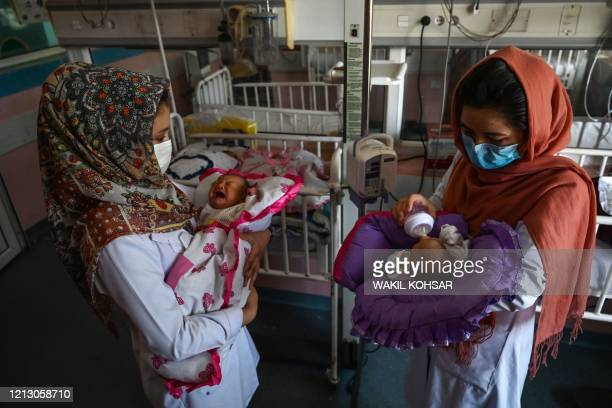 Nurses feed newborn babies rescued and brought to Ataturk Children hospital after their mothers were killed during a gunmen attack on a maternity...
