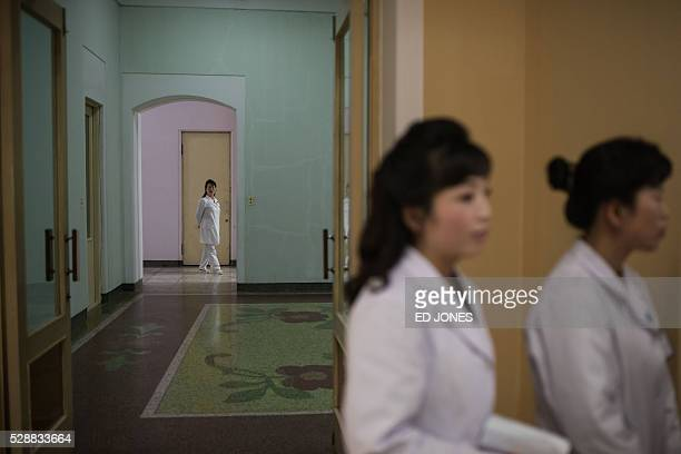 Nurses follow journalists at the Pyongyang Maternity Hospital during a governmentorganised media tour in Pyongyang on May 7 2016 North Korea...