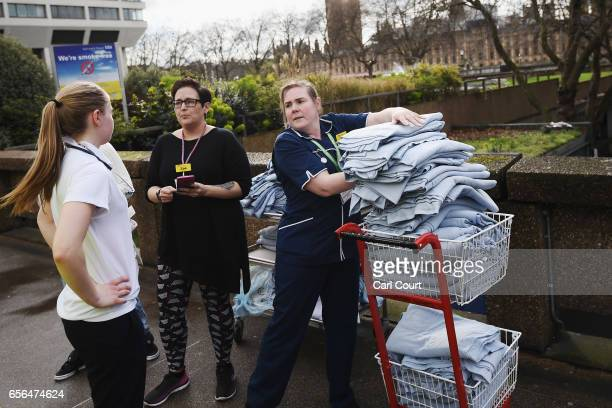 Nurses from St Thomas' hospital load blankets outside the hospital on March 22 2017 in London England A police officer has been stabbed near to the...