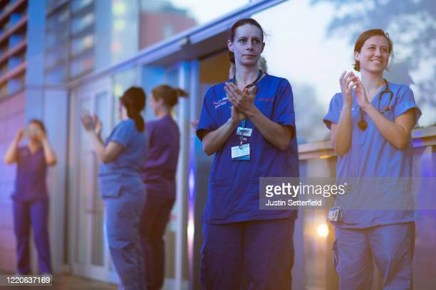"""Nurses from The Royal London clap outside the hospital on April 23, 2020 in London, England. Following the success of the """"Clap for Our Carers""""..."""
