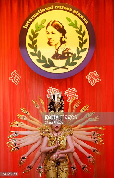 Nurses from the Third Hospital of Peking University perform the dance ThousandArm Goddess of Mercy during a show to mark the upcoming International...