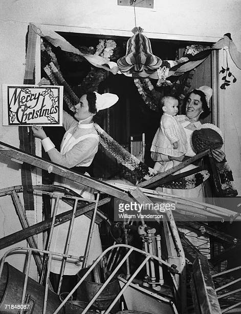Nurses hanging Christmas decorations in a ward at Great Ormond Street Children's Hospital even though it had been damaged by several air raids 5th...