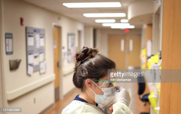 Nurses in the COVID19 unit of MedStar St Mary's Hospital check the fit of protective equipment before entering a patient's room March 24 2020 in...