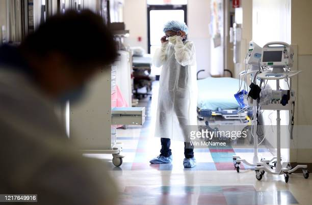 Nurses in the emergency department of MedStar St Mary's Hospital don personal protective equipment before entering a patient's room suspected of...