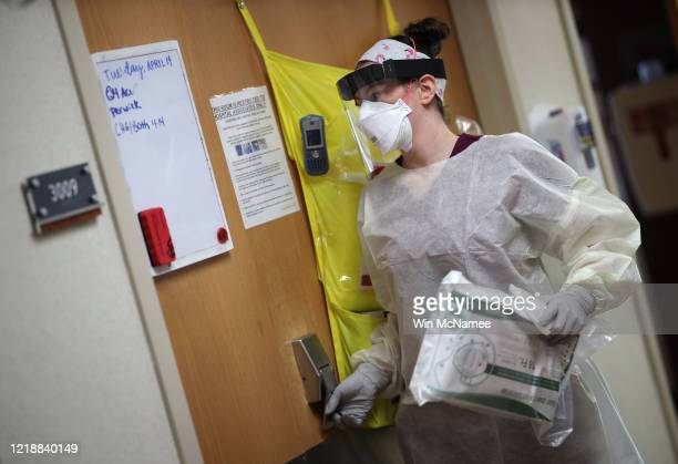 Nurses in the intensive care unit of MedStar St Mary's Hospital prepare to enter a COVID19 patient's room April 14 2020 in Leonardtown Maryland...