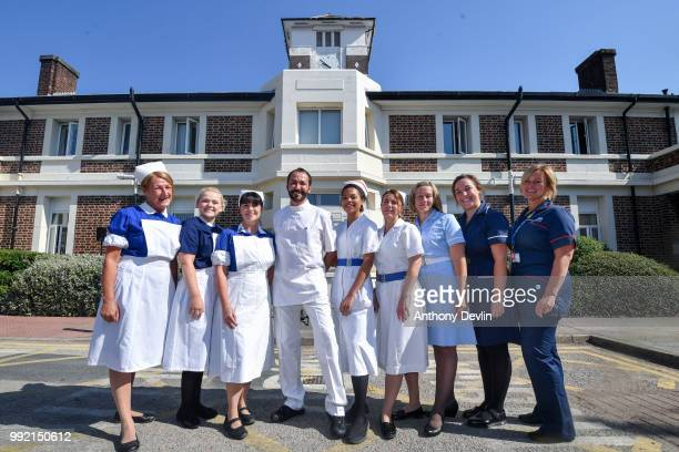 Nurses in uniforms to represent each decade of the NHS pose outside Trafford Hospital to celebrate the 70th birthday of the NHS at Trafford Hospital...