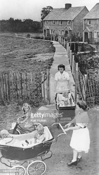 Nurses Lucie Taylor and Iris Crook take the 16month old quad sisters of the Good family Elizabeth Jennifer Bridget and Frances out for a walk at...