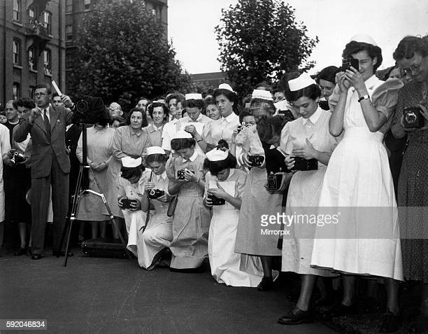 Nurses of the London Hospital in Whitechapel wait to take a picture of Her Majesty Queen Mary during the Royal visit to the hospital 16th June 1950