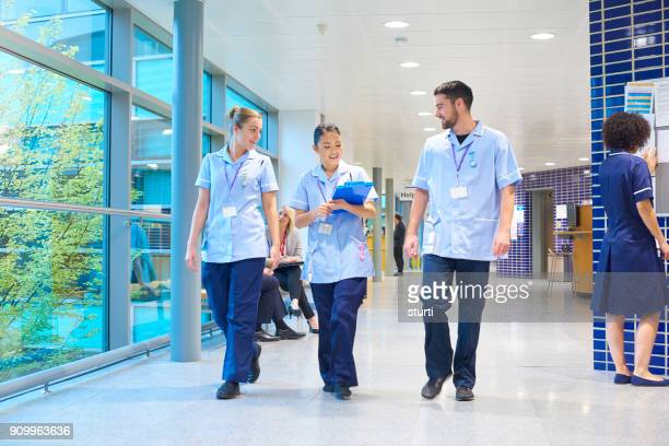 nurses on shift - nhs stock photos and pictures