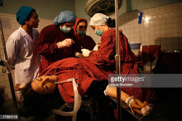 Nurses prepare a critical case Ziajanage 35 for an emergency operation as she is suffering from bleeding and a ruptured placenta at the Malalai...