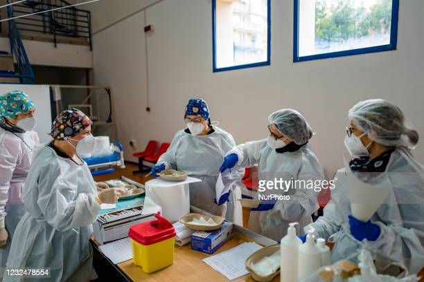 Nurses prepare the vaccines before administering them to people over 70, on the first day of opening of the Palachicoli in Terlizzi on 23 April 2021....