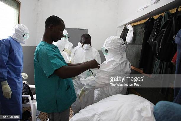 Nurses prepare to enter the Ebola ward at JFK Hospital in Monrovia, Liberia. After a doctor at the hospital contracted the virus, some employees quit...