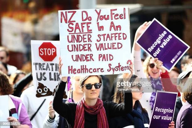 Nurses protest up Queen Street on July 12 2018 in Auckland New Zealand Thousands of nurses voted to walk off the job for the first time in 30 years...