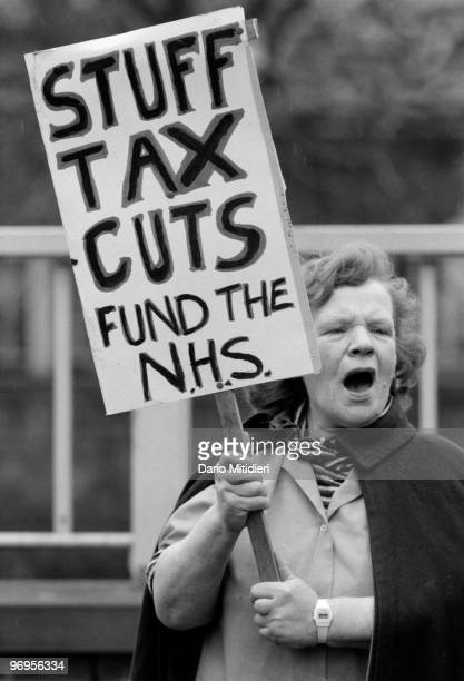Nurses protesting against cuts in NHS funding proposed by the Thatcher's government London UK 1984