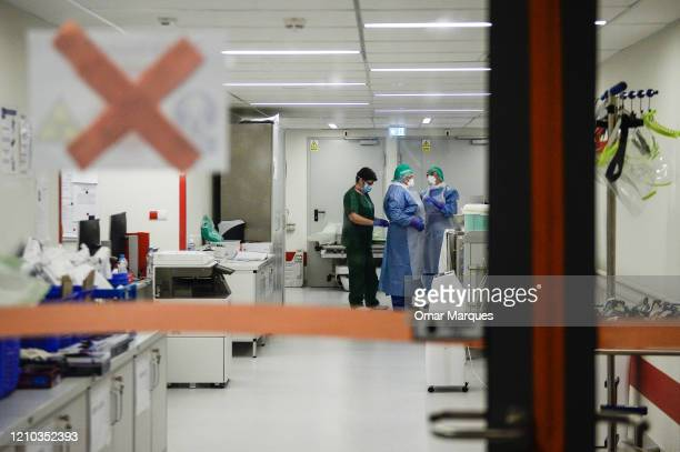 Nurses put on protective suits masks goggles and gloves before they enter the Intensive Care Unit for COVID 19 patients of Krakow's University...