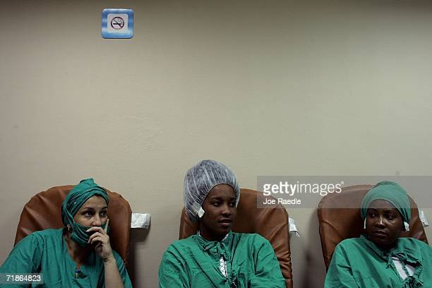 Nurses relax together between operations on the eyes of patients participating in Operacion Milagro September 12 2006 at Pando Ferrer hospital in...