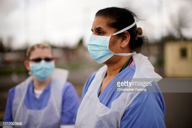 NHS nurses speak to the media as they wait for the next patient at a drive through Coronavirus testing site on March 12 2020 in Wolverhampton England...