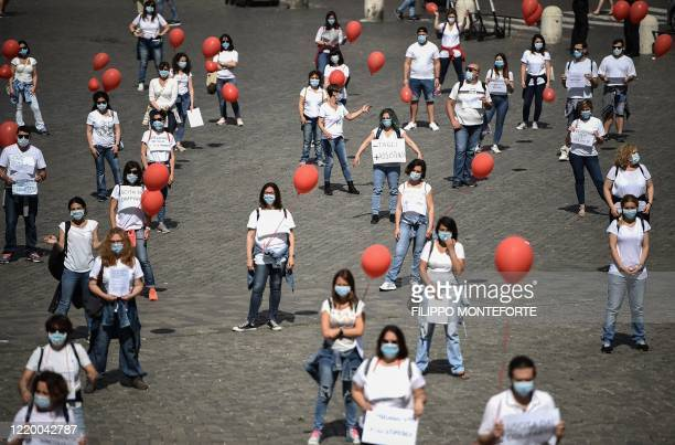 Nurses stage a flashmob protest over contracts, wages, precarious employment and job rights on June 15, 2020 on Piazza del Popolo in Rome, as the...
