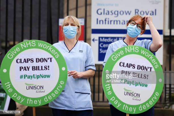 Nurses stage a protest outside Glasgow Royal Infirmary after being left out of a public sector pay rise on August 18, 2020 in Glasgow, United...