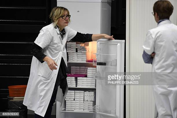 Nurses stand next to a fridge containing vaccins against meningitis on January 4 2017 at the University of Dijon Thirty thousand people are invited...