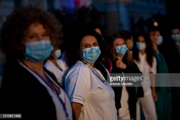 Nurses take part in a happening to say thank you nurses as the world is marking International Nurses Day at the INMI Spallanzani Hospital during...