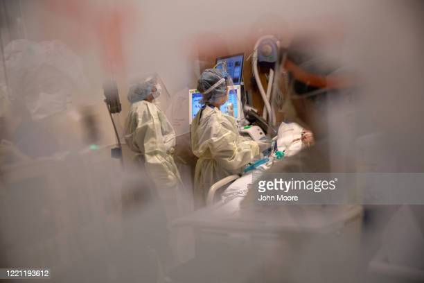 Nurses tend to a COVID-19 patient in a Stamford Hospital intensive care unit , on April 24, 2020 in Stamford, Connecticut. Stamford Hospital, like...