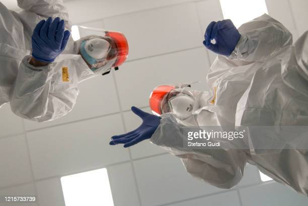 Nurses wear personal protective equipment before starting to work on the preparation of the Intensive care unit in the new COVID19 Hospital on March...