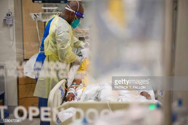 Nurses wearing personal protective equipment attend to patients in a Covid-19 intensive care unit at Martin Luther King Jr. Community Hospital on...