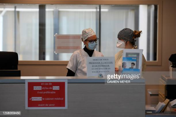 Nurses wearing protective face masks are pictured in a doctor's office in Tinténiac western France on March 27 as the nation battle to halt the...