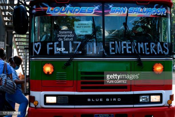Nurses who work at a hospital on the first line against the coronavirus COVID19 board a bus decorated to celebrate International Nurses Day after...