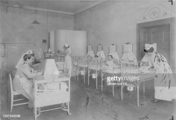 Nurses with babies in the dormitory of an orphanage - Vintage property of ullstein bild Published in: Die Praktische Berlinerin