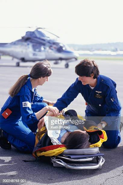 nurses with patient on stretcher brought from helicopter - medevac stock photos and pictures
