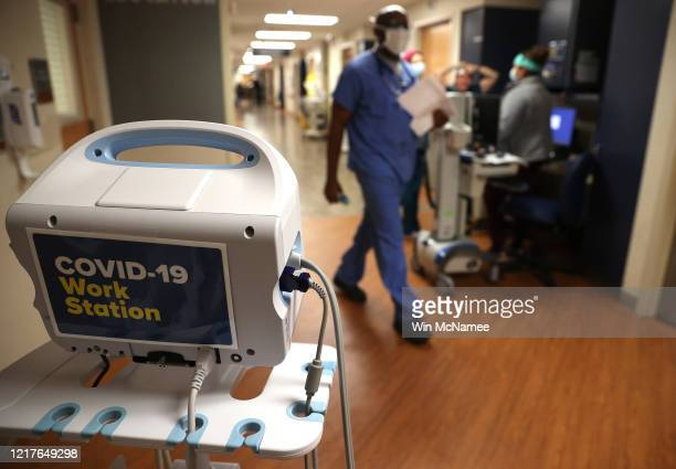 Nurses work outside of the room of a coronavirus patient at MedStar St Mary's Hospital April 8 2020 in Leonardtown Maryland MedStar St Mary's...