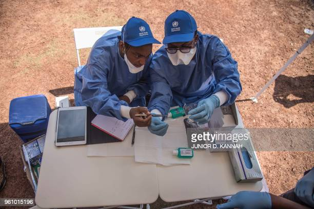 Nurses working with the World Health Organization prepare to administer vaccines at the town all of Mbandaka on May 21 2018 during the launch of the...