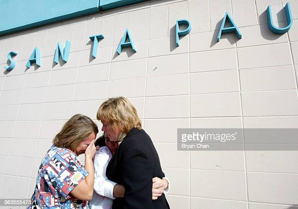 Nursing assistants Rebecca Garcia left and Patty Sanchez weep with Sue Houx after the closing of Santa Paula Memorial Hospital Friday Houx was a...