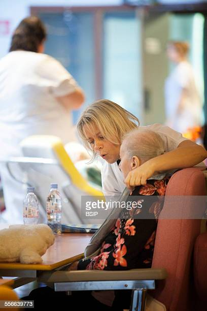 Nursing Home Residents State nursing home in HauteSavoie France An auxiliary nurse chats to a resident at meal time