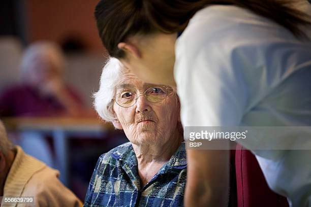 Nursing Home Residents State nursing home in HauteSavoie France An auxiliary nurse chats to a resident