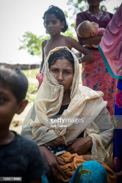 nursing mother in rohingya refugee camp in bangladesh - bangladesh mother stock pictures, royalty-free photos & images