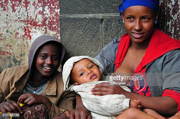 Nursing mother with children in Addis Ababa, Ethiopia