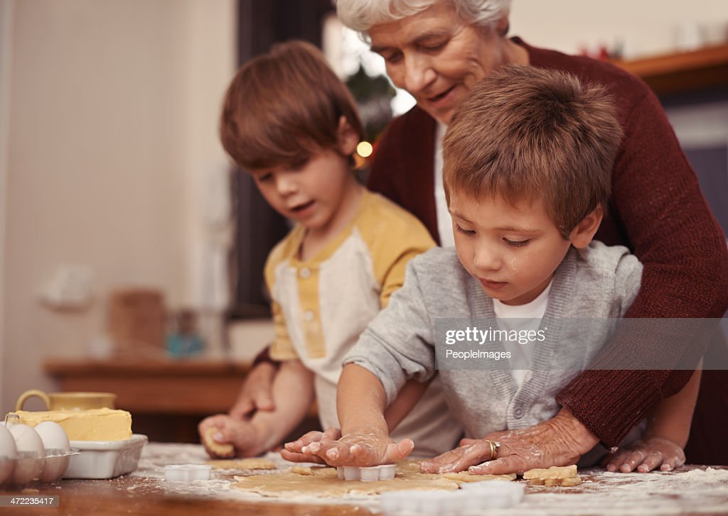 Nurturing budding little bakers : Stock Photo
