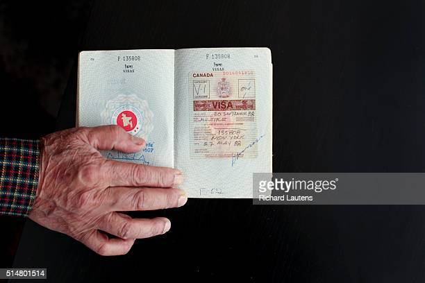 TORONTO ON MARCH 1 Nurul holds his passport with a Canadian visa for 1988 Nurul Islam immigrated to Canada with his family from Bangladesh in 1988 He...