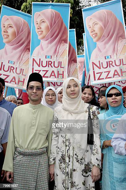Nurul Izzah Anwar daughter of former deputy prime minister and defacto opposition People's Justice Party leader Anwar Ibrahim poses with supporters...