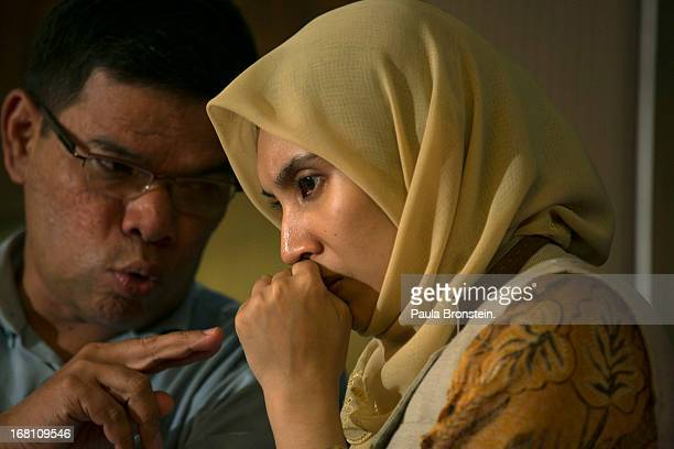 Nurul Izzah daughter of Anwar Ibrahim listens during a late evening press conference concerning the results of the general elections which he claims...