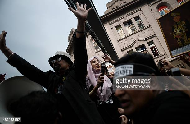 Nurul Izzah daughter of jailed Malaysia's opposition leader Anwar Ibrahim addresses a protest march in Kuala Lumpur on March 7 2015 Several thousand...