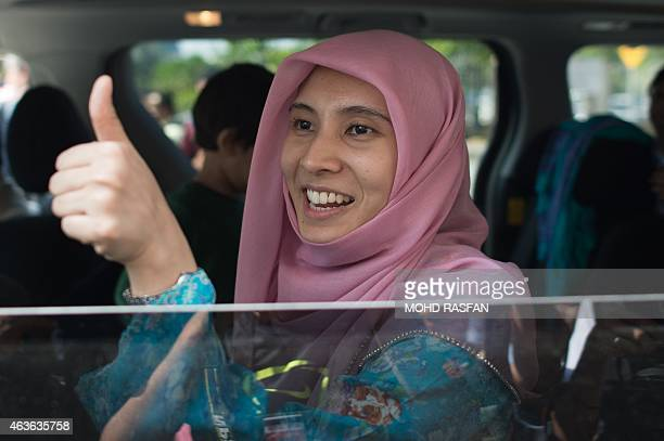 Nurul Izzah daughter of Malaysian opposition leader Anwar Ibrahim gestures as she leaves after her father's legal case against Malaysian Foreign...