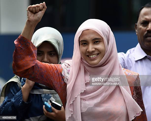 Nurul Izzah daughter of Malaysian opposition leader Anwar Ibrahim gestures after being released on bail at Dang Wangi police station in Kuala Lumpur...